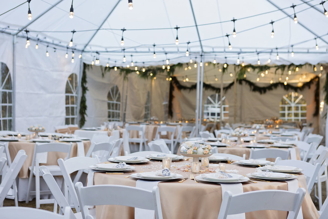 winter wedding reception under tents with string lights and side panels