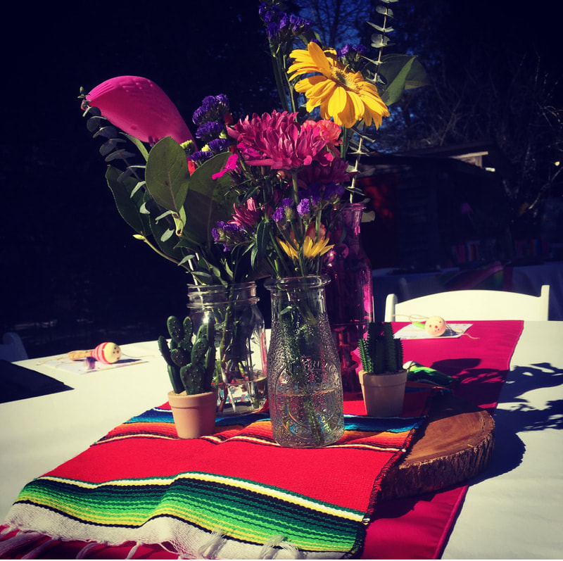 Flower centerpieces for fiesta themed baby shower