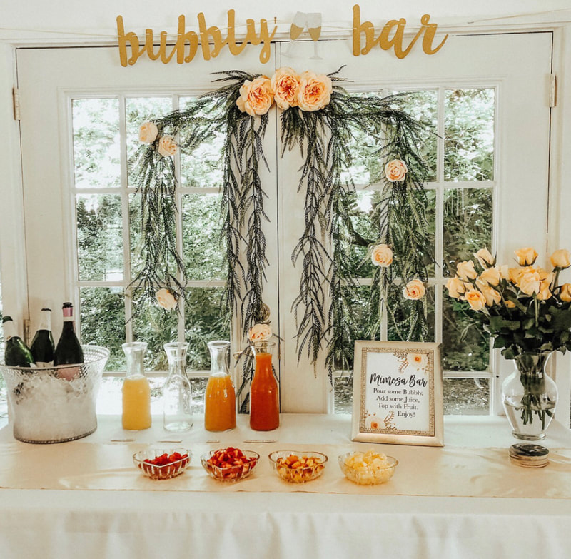 rose and peach themed mimosa bar