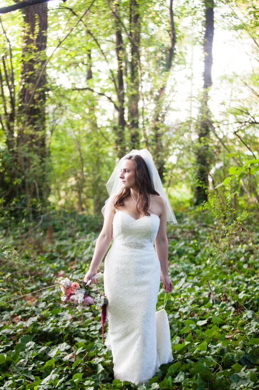 bride posing in forest during post-ceremony photos