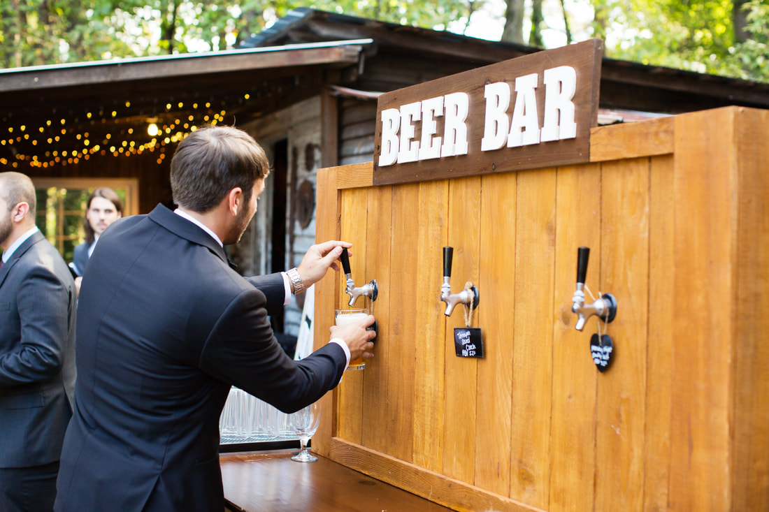 guest getting drink from four oaks manor's beer bar