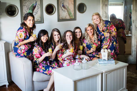 bride and bridesmaids drinking mimosas in bridal suite at four oaks manor in buford