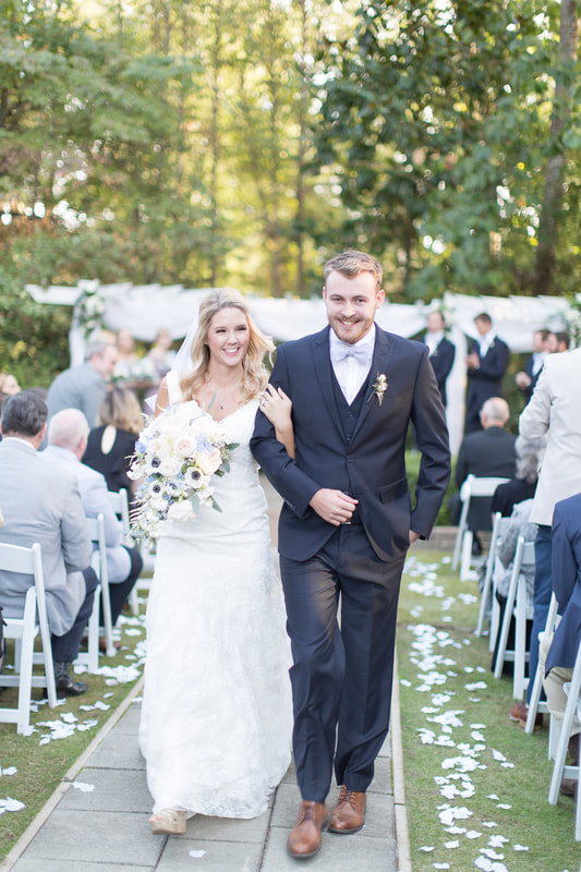 husband and wife walking down aisle after ceremony