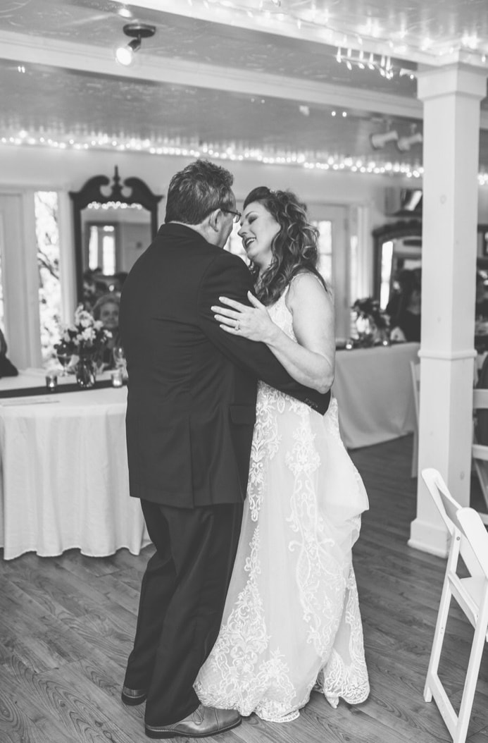 black and white photo of father daughter dance indoor wedding