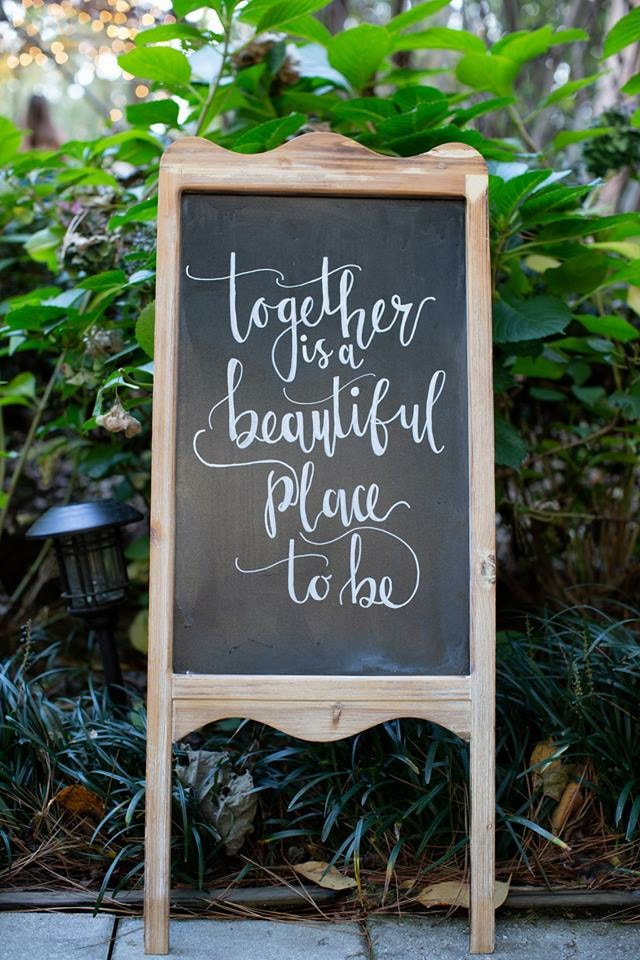 together is a beautiful place to be chalkboard sign