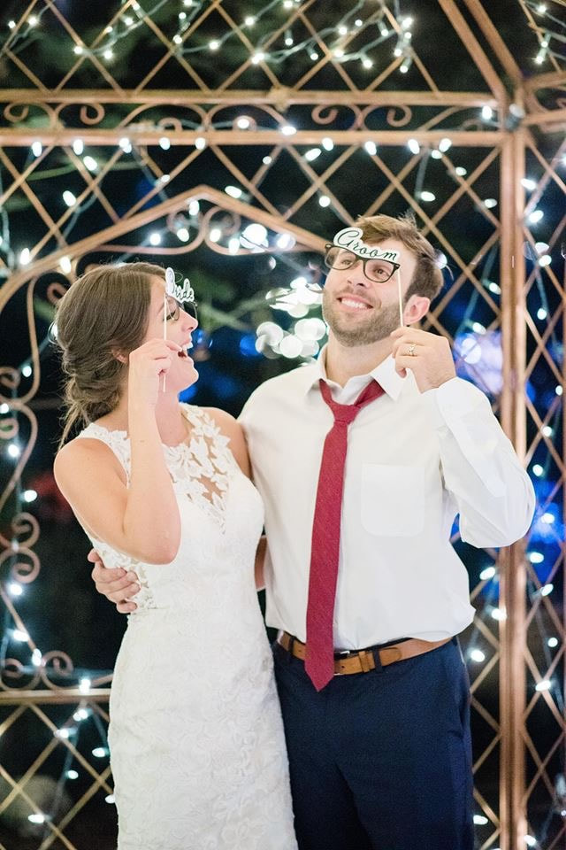 couple with bride and groom glasses photo booth props