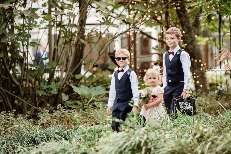 ring bearers and flower girl walking down aisle during processional