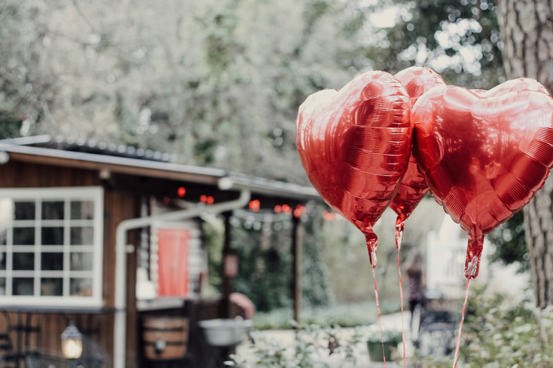 Four Oaks gardens decorated for Valentine's Day with heart balloons and red lights