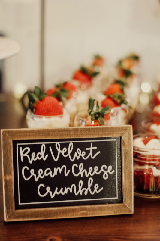 mini desserts with chalkboard sign