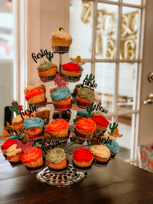 colorful cupcake display fiesta baby shower