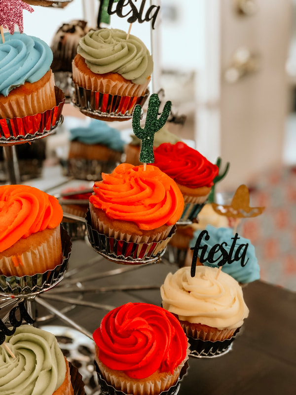 brightly frosted cupcakes with fiesta toppers