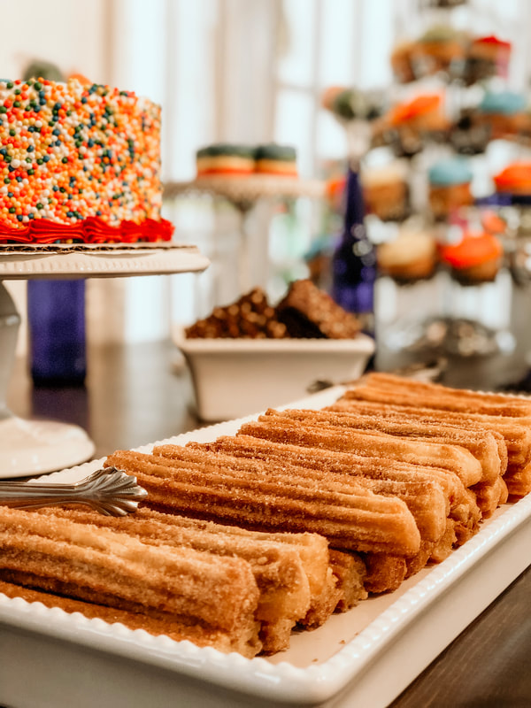 churros at dessert bar for baby shower