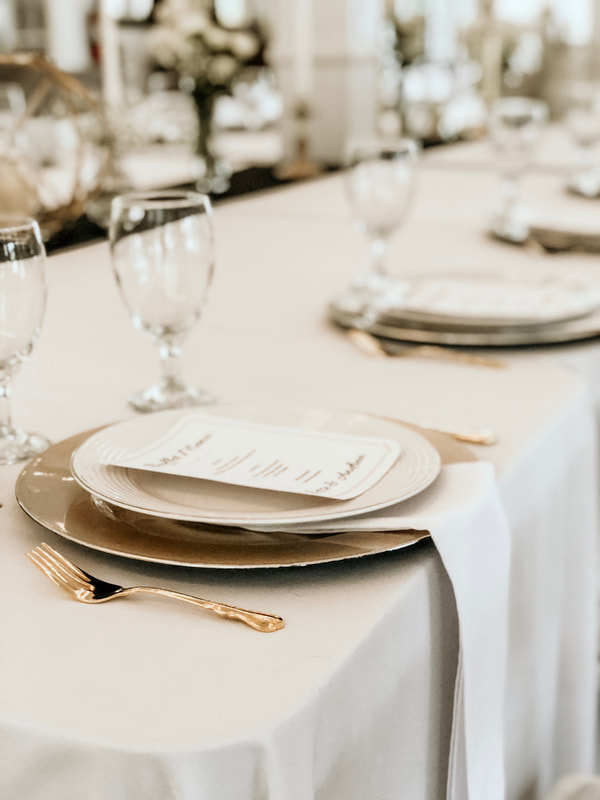 menu and plate settings for rehearsal dinner