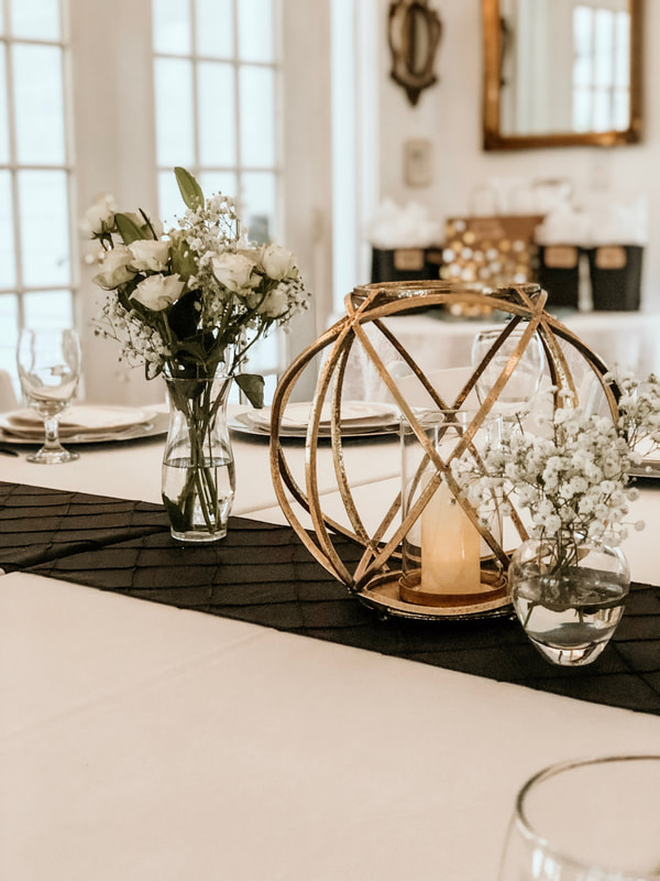 gold centerpiece with white floral arrangements