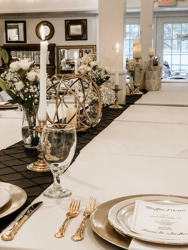 gold and black rehearsal dinner