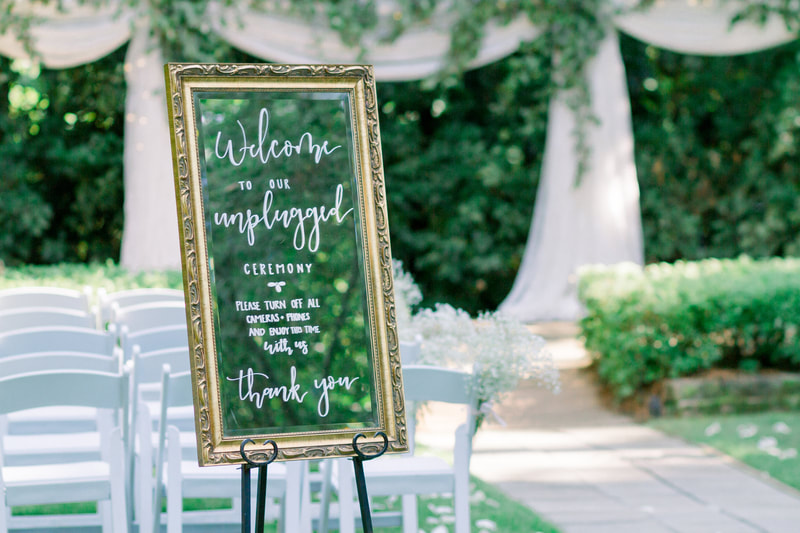unplugged ceremony sign on gold mirror
