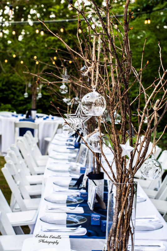 winter party centerpieces with branches and glass ornaments