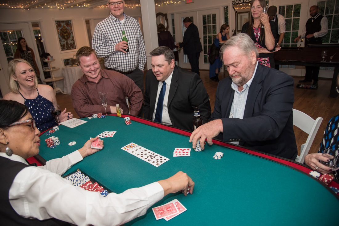 wedding guests playing poker during March reception inside carriage house
