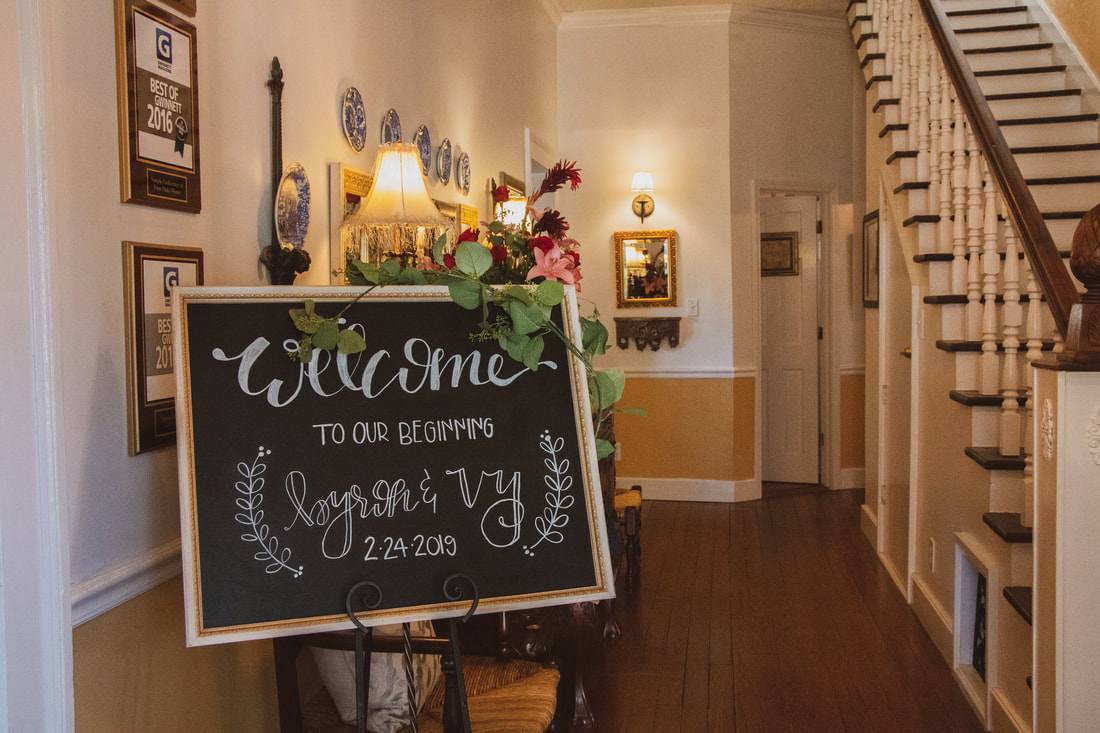 farmhouse entryway with welcome chalkboard sign