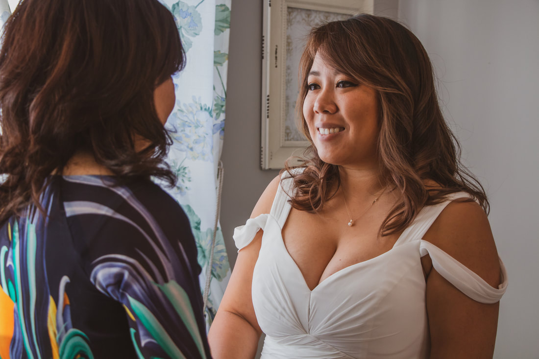 bride smiling at mother in bridal suite