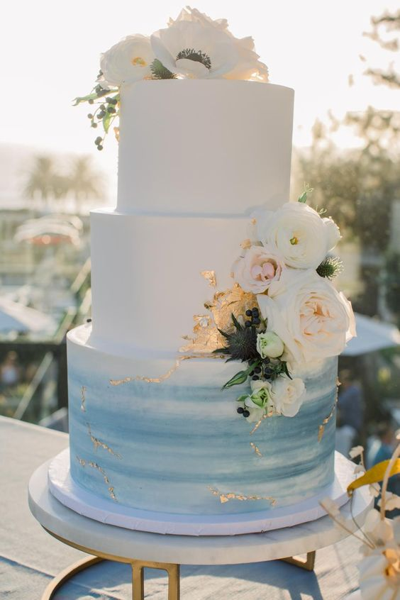 beach wedding cake with blue frosting and gold details