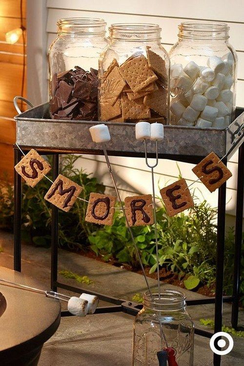 smores bar with banner made from graham crackers