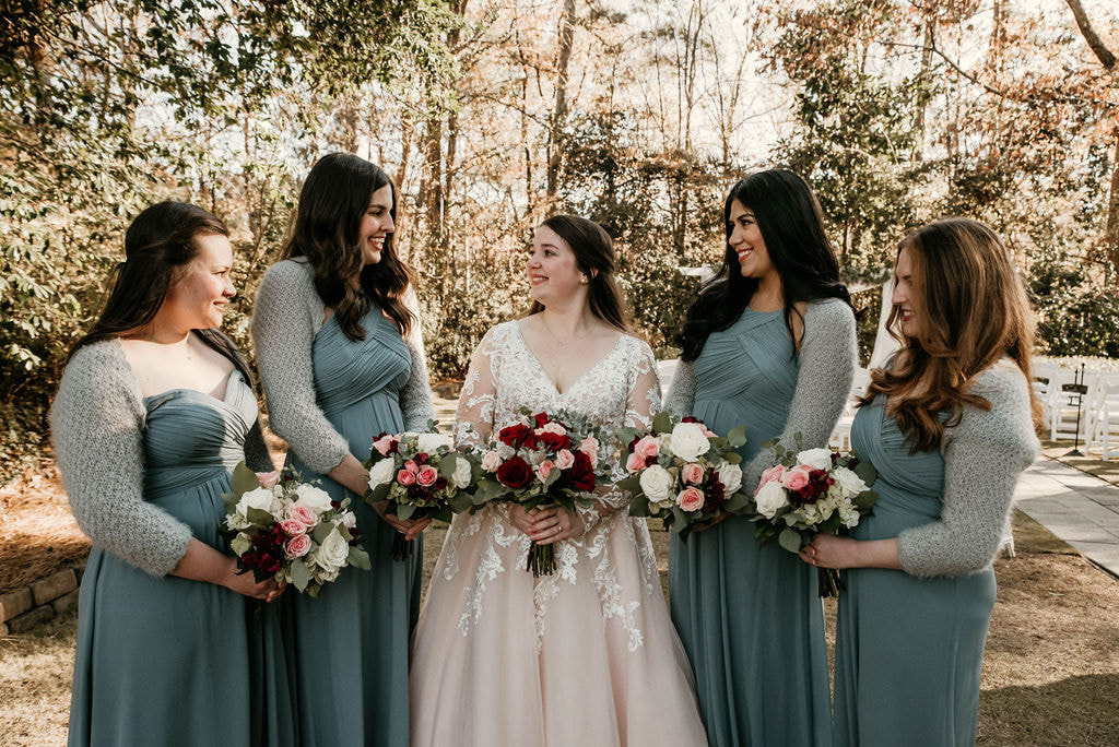 winter bride and bridesmaids in blue dresses