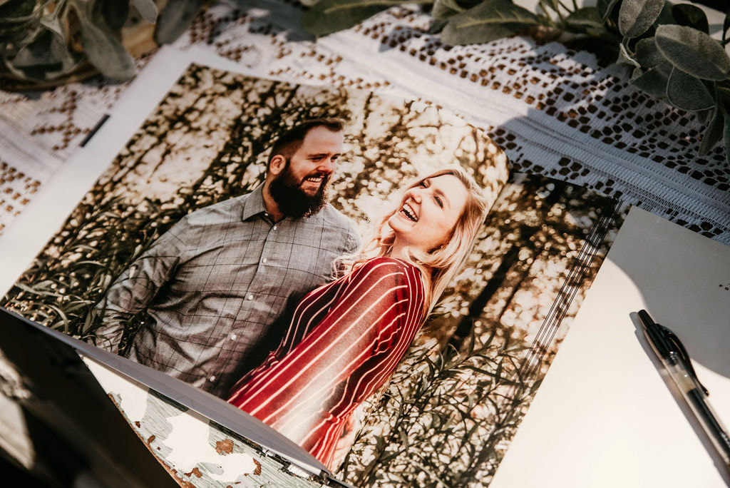 guestbook page filled with couple's engagement photo