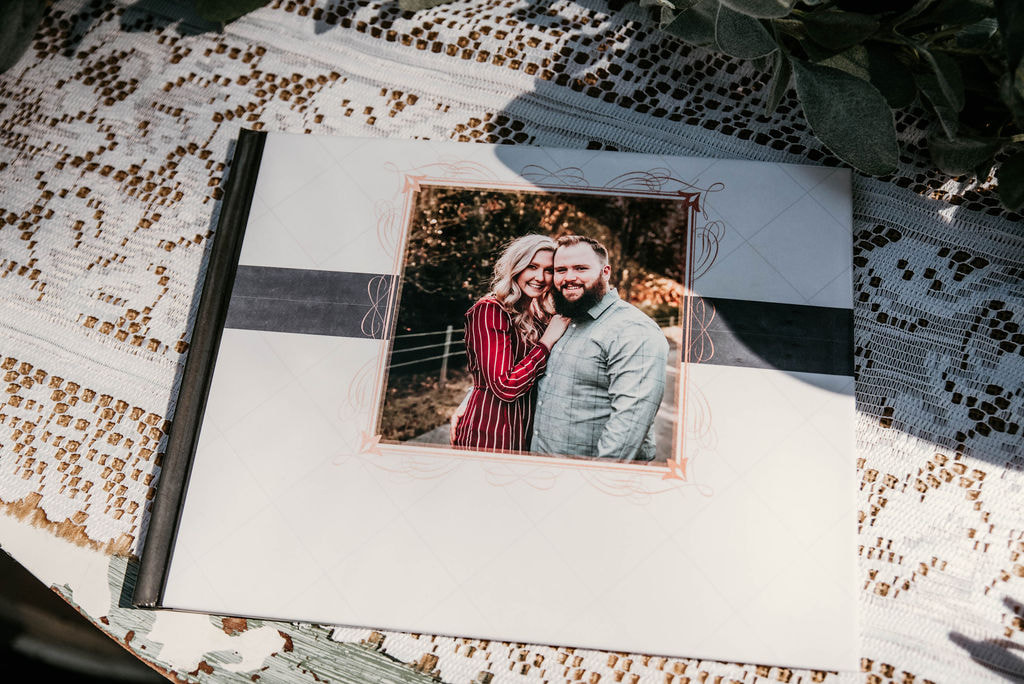 guestbook on rustic guestbook table with engagement photo of couple