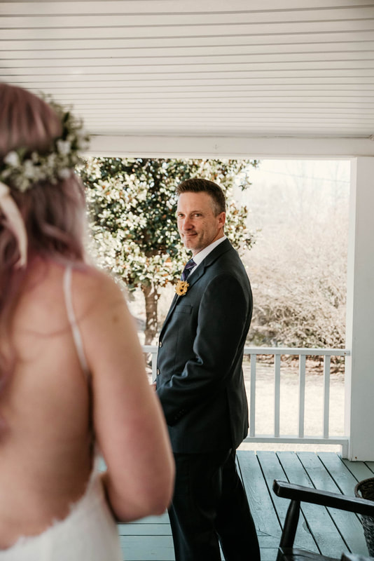 father turns around on front porch for first look with bride
