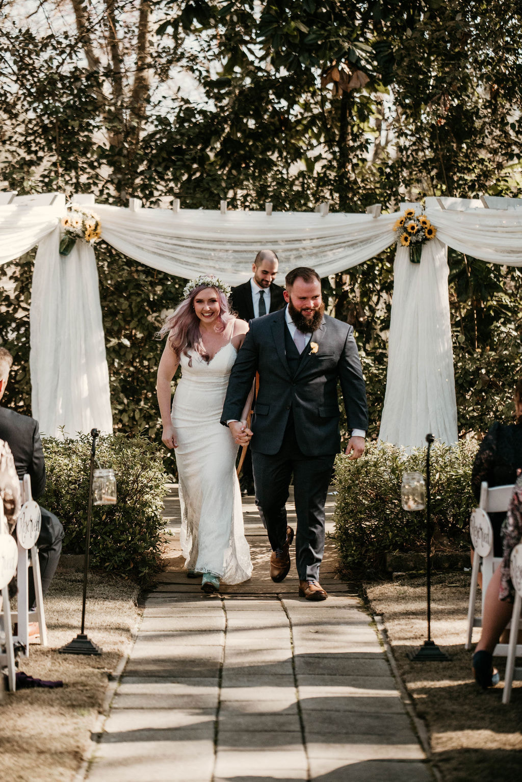 newlyweds walking down aisle after ceremony