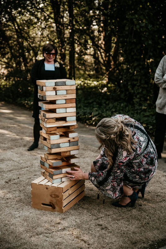 wedding guests playing giant jenga