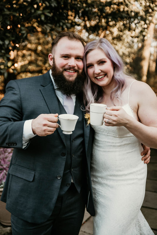 newlyweds holding white china coffee mugs
