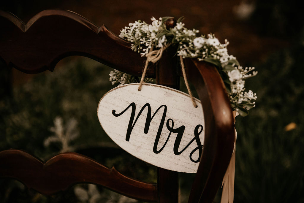 wood chair with Mrs. wood sign and flower crown