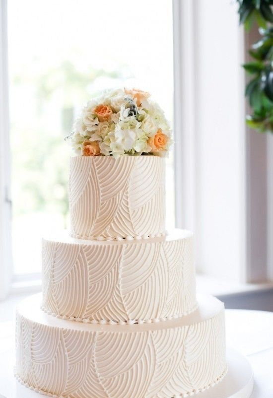 textured wedding cake with flower cake topper