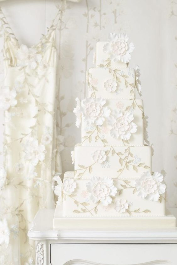 5-tiered square white wedding cake with white flower details