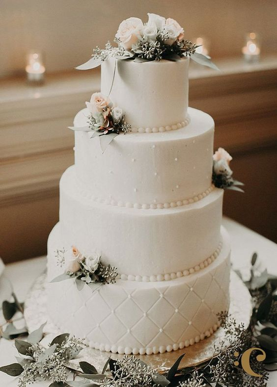 elegant, classic wedding cake with simple piping