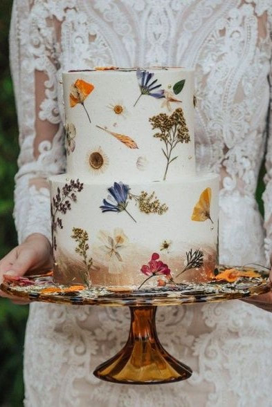 vegan wedding cake with dried flowers and metallic food paint