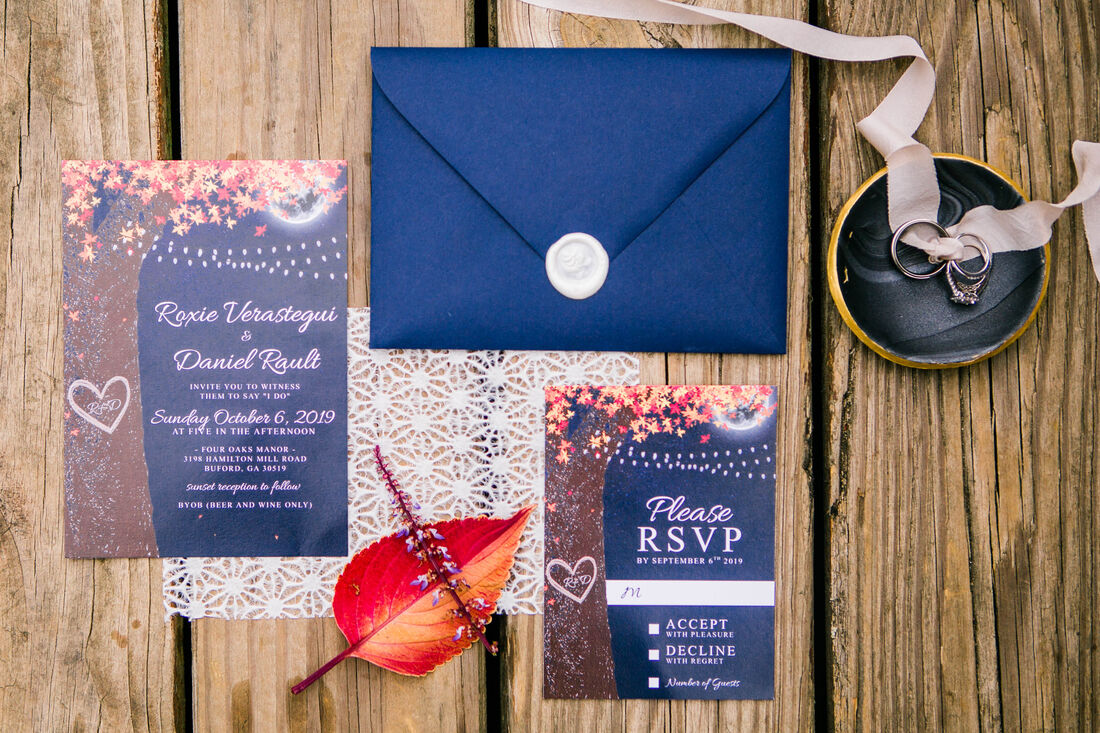 fall themed wedding invitations on wood table